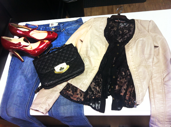 a sleek leather jacket pairs with red patent heels, a lace top, quilted bag and denim