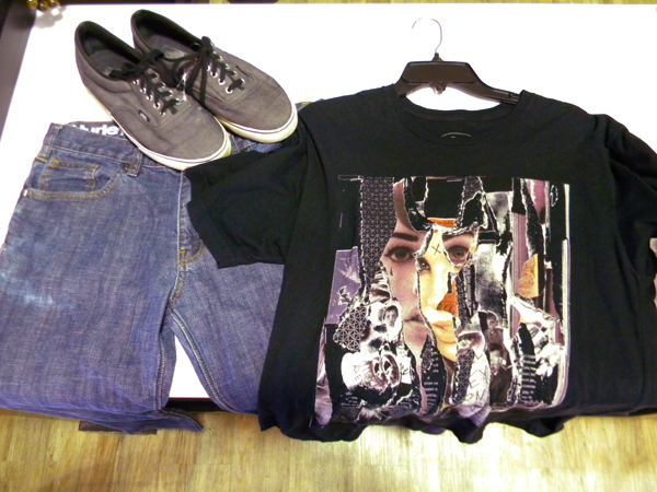 a funky graphic t-shirt paired with sneakers and denim