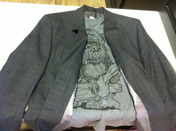 A gray men's t-shirt is paired with a suit jacket