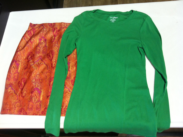 A green longsleeve t-shirt is paired with an Escada paisley mini skirt