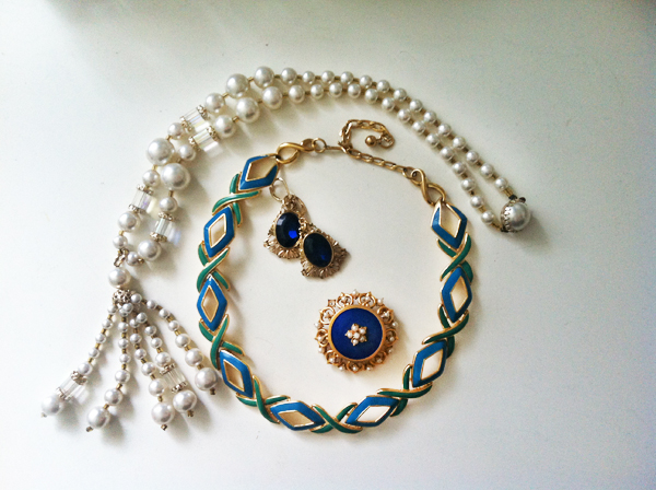 Just part of my Goodwill jewelry collection: 2 necklaces, earrings and a brooch