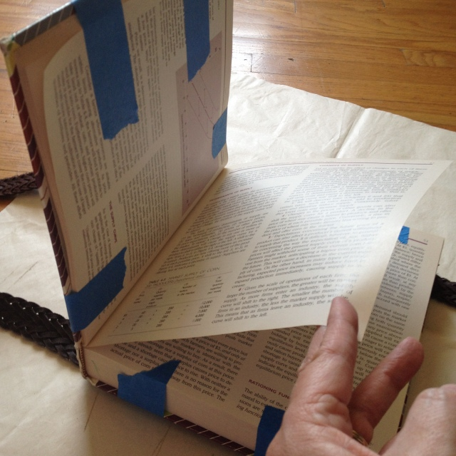 "Step 5: Pull one page from the upper portion of the book and rest it down to the ""shelf"" portion of the book.  You will see why this is important on a later step."