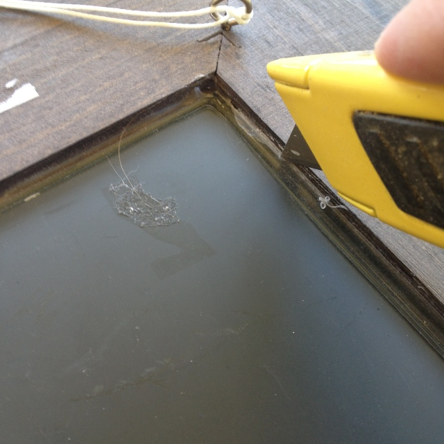 Step 1-Cut the adhesive holding the mirror in place