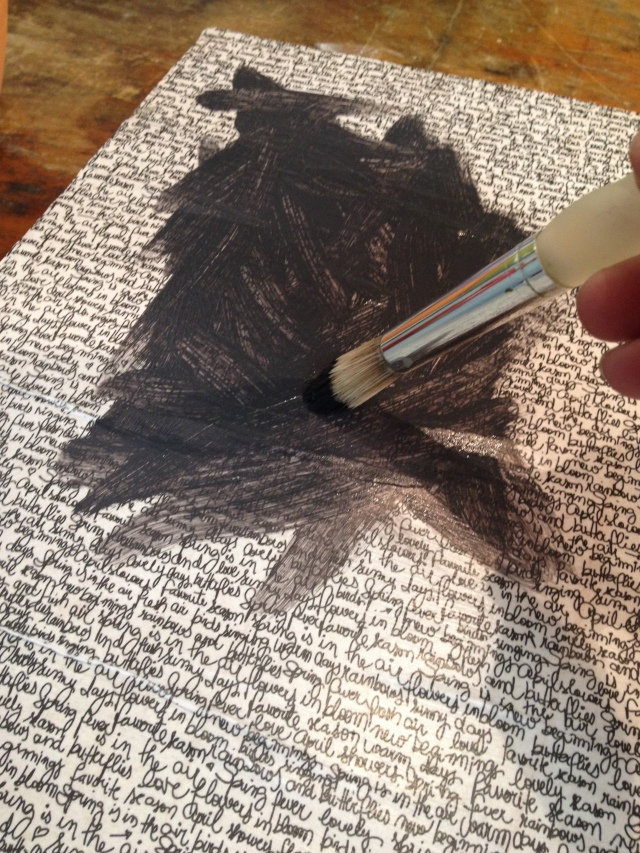 Step 11-Randomly brush on charcoal colored paint onto front of canvases leaving an organic edge with approx three quarter inch border of paper showing