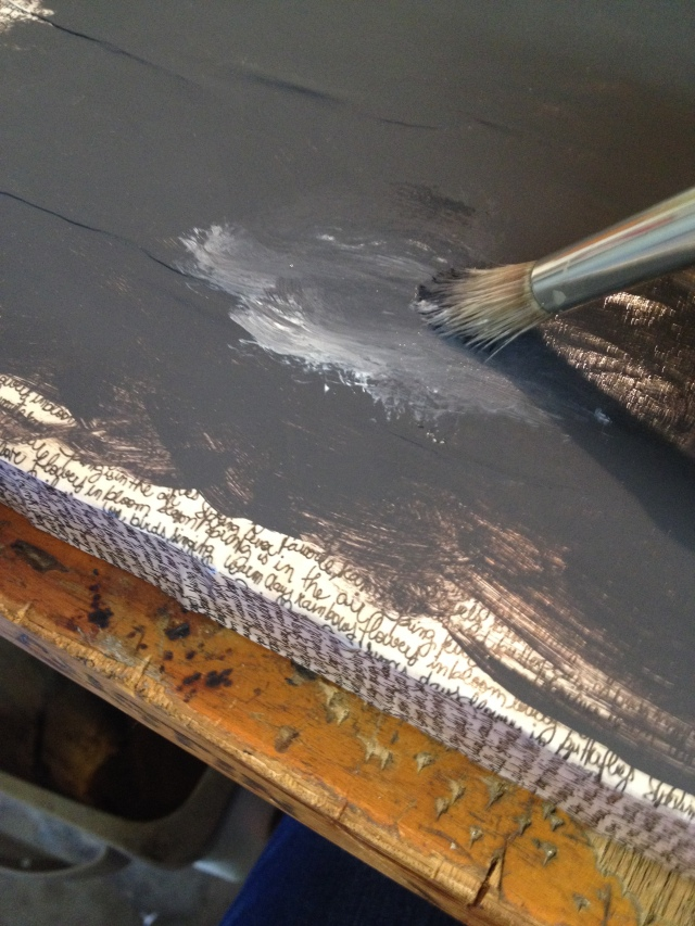 Step 13-With the same brush start rubbing in a small amount of white paint into the wet charcoal paint