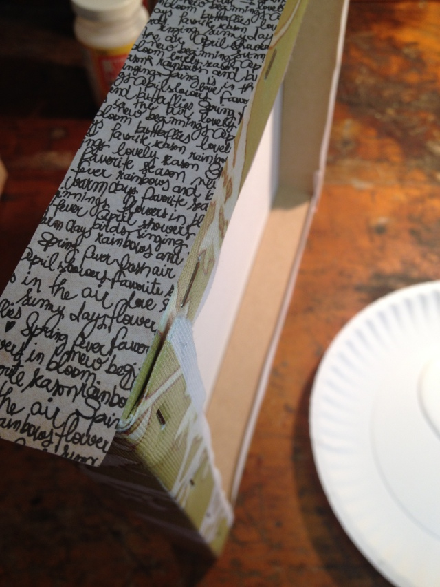 Step 6-Lay the cut-to-size piece of scrapbook paper on top of the decoupage medium and rub it flat with your finger